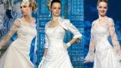 Весільна сукня з рукавом